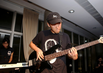 A Student Playing the Bass