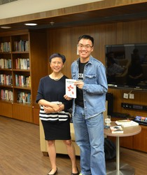 Xu Xi with Ambrose Chan, winner of one of the books and contributor to this news piece