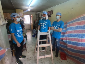In groups, students work on repairing apartments in Tsuen Wan with Habitat for Humanity