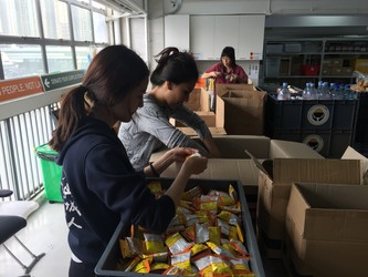 Students pack snacks at Feeding HK