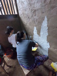 Students painting walls