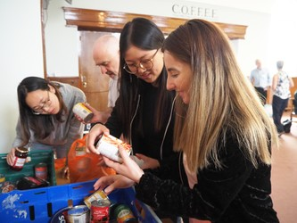 Students pack food at the York Food Bank